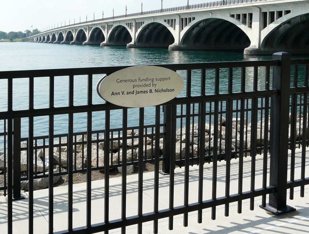 Etched Stainless Steel Plaque: The donor name is etched on both sides of this fence mounted plaque.