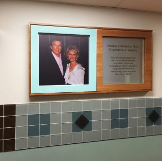 Custom Memorial Plaque With Photo - A beautiful handcrafted wood and metal donor / memorial plaque. Wayne State University wanted to recognize one of their high level donors by presenting them with this plaque. This plaques recognizes Michael Ilitch, Sr. for contributing to a major hospital surgical center. The plaque is stainless steel with a printed photo in a solid cherry wood frame.