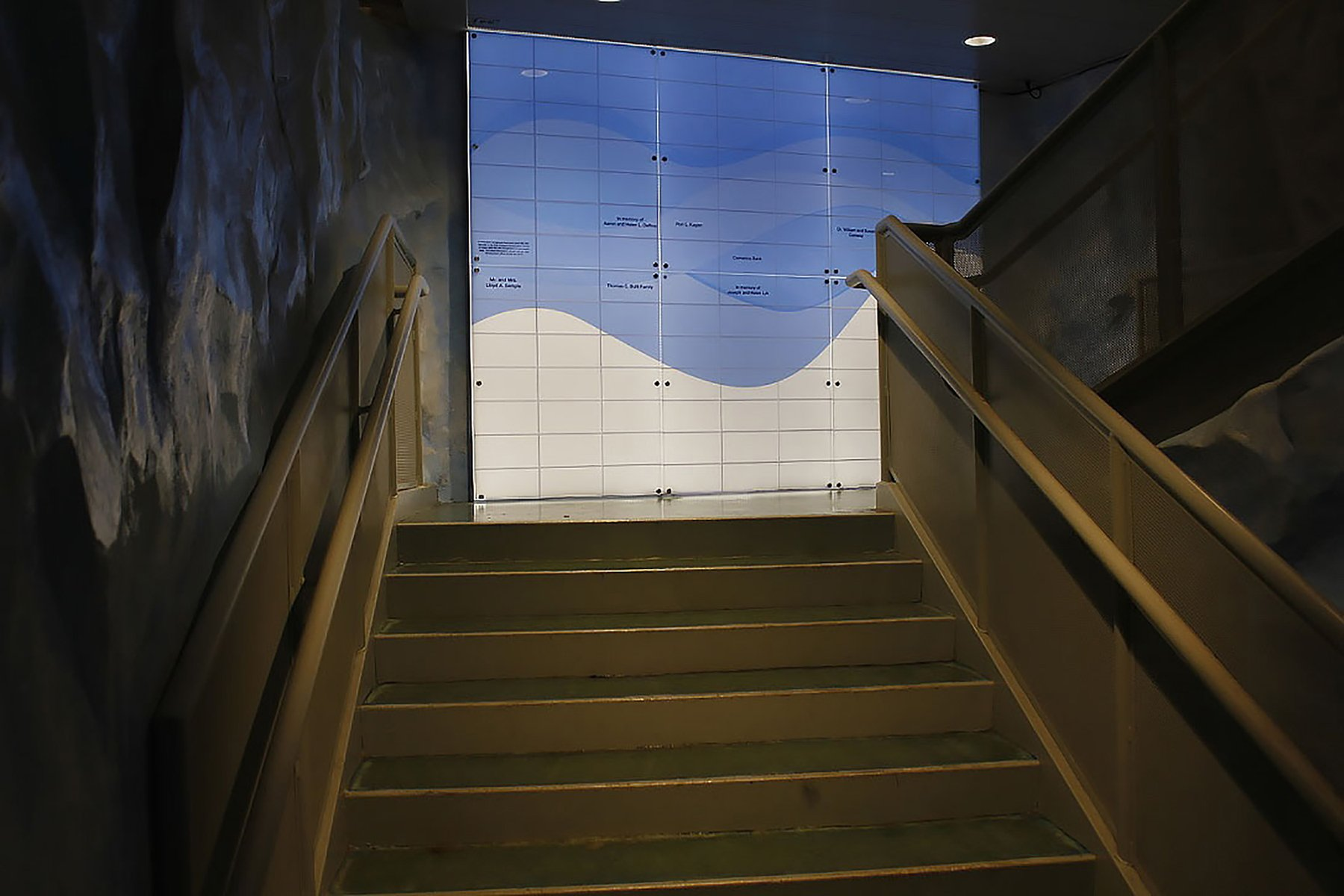 This wall is located as you are leaving the facility and is designed to illuminate the stairwell, as well as making it more fun. It is constructed of three layers; first there are 4' LED Panels, a printed wave pattern is set in front of the panels, and finally the third layer is clear acrylic with cut grooves to resemble ice bricks. Vinyl decals are used for the donors names and are placed on the inside of the ice bricks.Annual Donor Wall